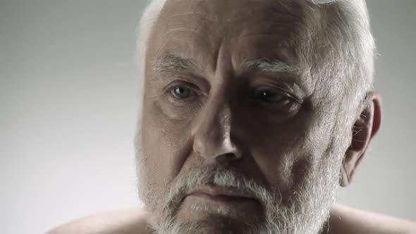 Thumbnail for Contemplative senior man