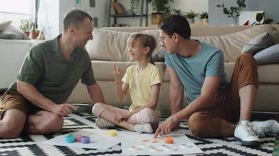 Parents And Kid Painting