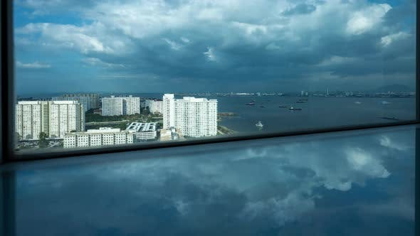 time-lapse of sea and cloud, view from building near the sea