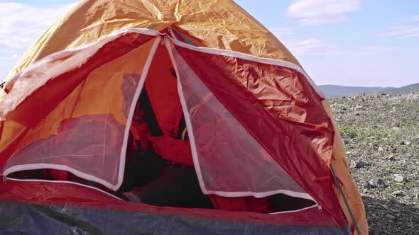 Thumbnail for Female Camper Sitting in Tent
