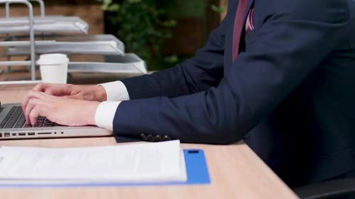 Close Up Shot of Businessman Hands Typing on Laptop