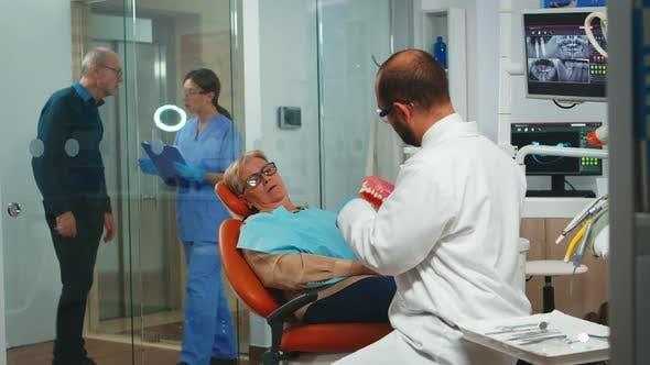 Stomatologist Holding Plaster Model of the Mandible