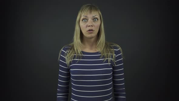 Woman in Black Striped Pullover Performs Shock Emotions