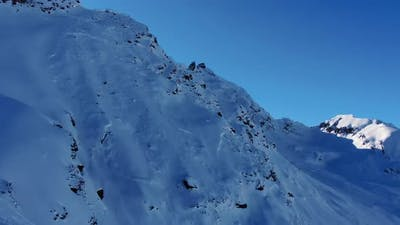 Picturesque Mountain Slopes in Highland Area Under Clear Sky