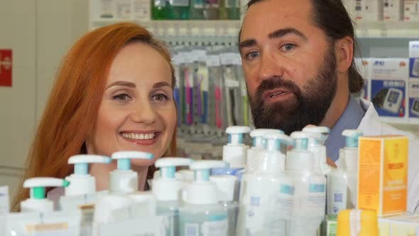 Thumbnail for Beautiful Woman Talking To the Pharmacist While Selecting Products To Buy