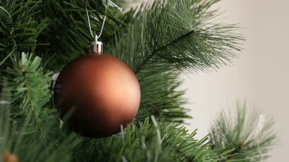 Thumbnail for Luxurious matte Christmas tree bauble shallow DOF decoration 4K 2160p 30fps UltraHD footage - Bronze