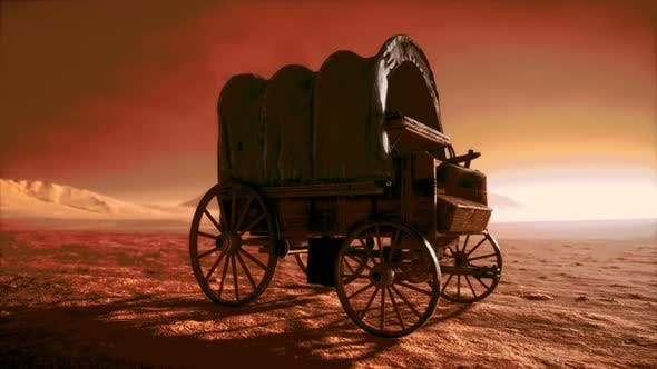 Thumbnail for Canvas Covered Retro Wagon in Desert at Sunset