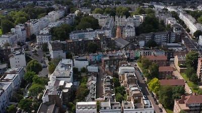 Slide and Pan Shot of Church Tower Among Town Houses in Urban Neighbourhood