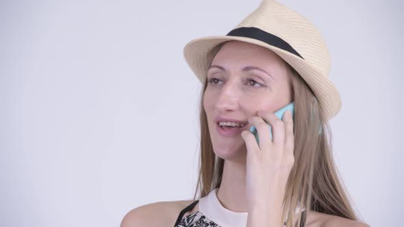 Cover Image for Face of Happy Blonde Tourist Woman Talking on the Phone