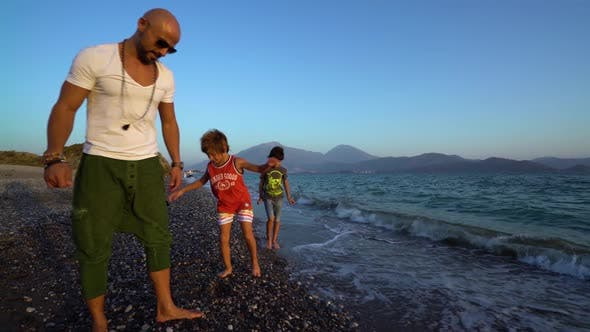 Cover Image for Father And Two Kids On The Beach