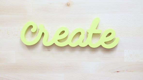 Thumbnail for Grün erstellen Schild mit Pinsel auf dem Tisch.