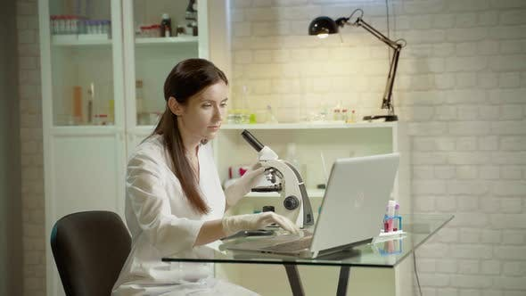 Thumbnail for Female Doctor In Laboratory With Microscope