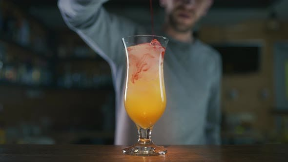 Thumbnail for Barman Adds Sirop To the Colorful Cocktail in Slow Motion, Making Cocktails in a Bar, Alcohol Drink