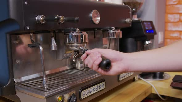 Barista Making Fresh Coffee From Coffee Machine.