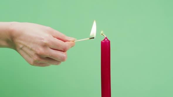 Hand firing a candle