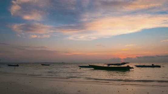 Thumbnail for Time lapse: sunset over tropical beach and sea colorful dramatic sky moving clou