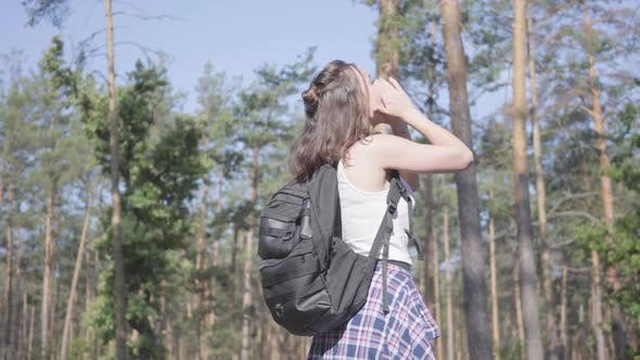 Thumbnail for Cute Young Woman Gets Lost in the Forest, She Calling for the Help. The Girl Is in Despair, She Is