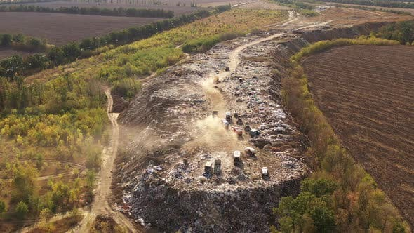 Aerial View of Large Garbage Pile at Sorting Site. Trucks Bring Waste To a Garbage Pile in Trash
