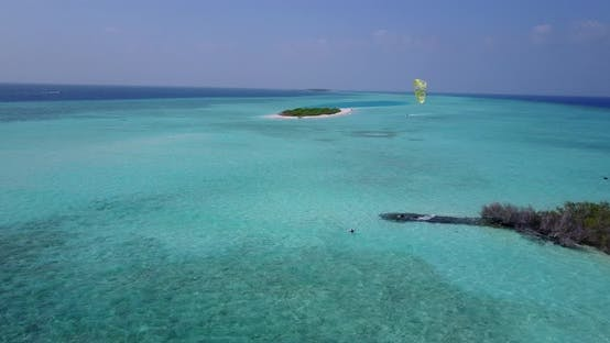 Thumbnail for Wide aerial island view of a white sandy paradise beach and blue sea background in best quality