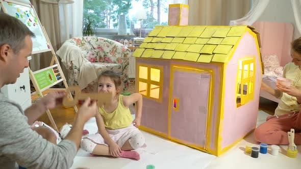 Thumbnail for Father Gives Happy Little Girl a Key To Her New Cardboard House.