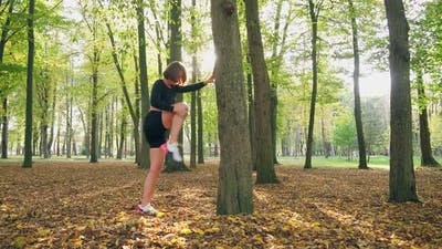 Attractive Woman Doing Fitness Exercises at Park