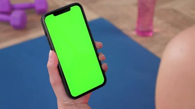 Green Screen Smartphone Close Up Smartphone in Hand Looks Green Isolate Display