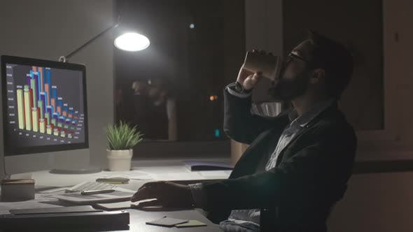 Man Working Late Before Deadline