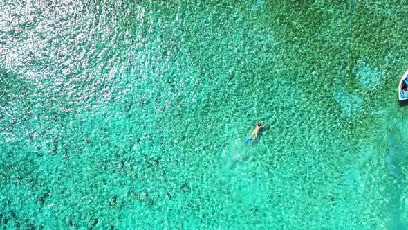 Thumbnail for Daytime overhead island view of a paradise sunny white sand beach and blue water background in color