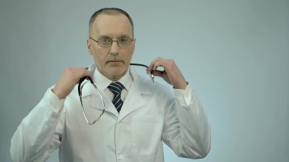 Thumbnail for Professional Therapist Putting Stethoscope Around Neck, Ready to Examine Patient