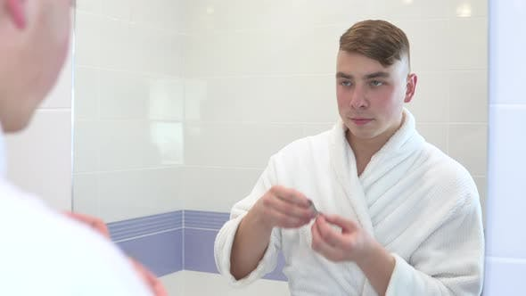 Thumbnail for A Young Man Puts Cosmetic Patches on His Face, Spa Treatments, Brown Hydrogel Patches for Skin
