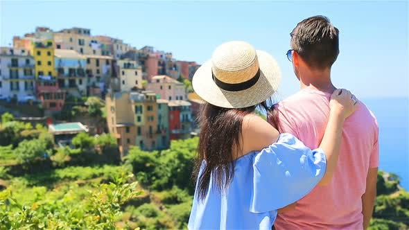 Thumbnail for Happy Couple with View of the Old Coastal Village Background of Corniglia, Cinque Terre National