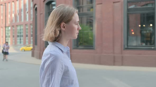 Side View of Woman Walking on the Street