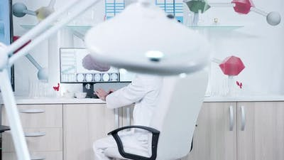 Man Works in Modern Research Center