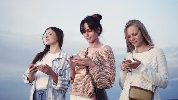 Thumbnail for Three Ladies Texting in Their Smart Phones in the Street