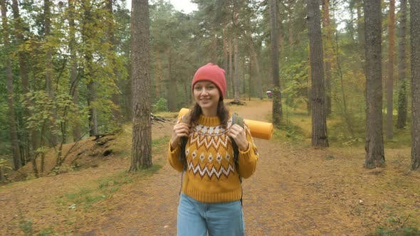Thumbnail for Happy Woman with Backpack Walks in Forest on Autumn Day