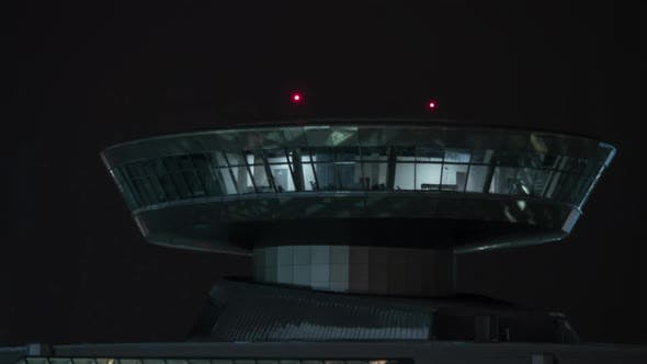 Time Lapse of Airport Control Tower with Red Lights at Night