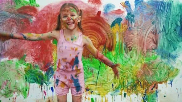 Thumbnail for Little Girl Child Preschooler Draws Hands Paints On White Wall.