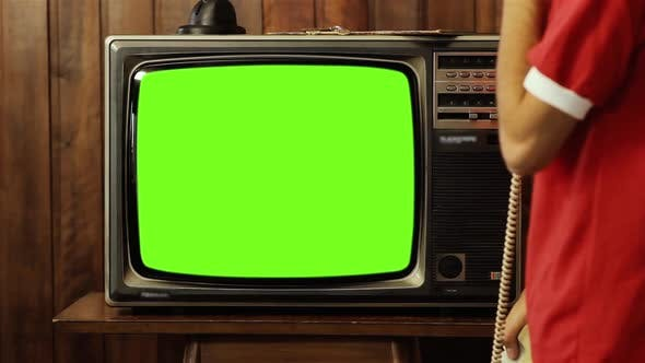 Thumbnail for Teenage Boy talking on Old Telephone and Watching Retro TV Green Screen.