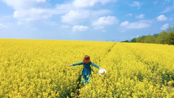 Thumbnail for Happy Girl Running Through The Rapeseed Field