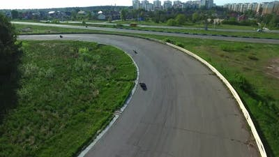 Motorcyclists Ride on Racing Track. Aerial View Moto Race on Racing Track