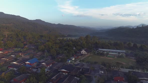Thumbnail for Cinematic Aerial View on Village in Mountains