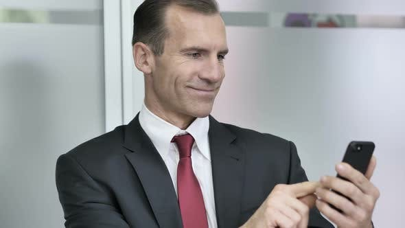Thumbnail for Businessman Using Smartphone in Office