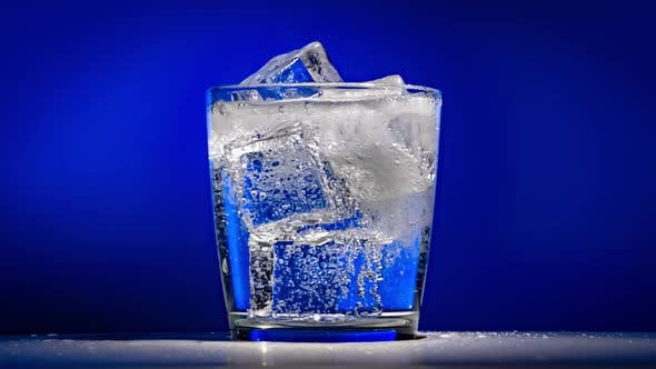 Thumbnail for Glass of Water with Ice on a Dark Blue Background