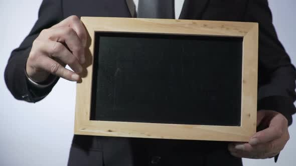 Thumbnail for Blackboard Template With Empty Space for Your Text, Businessman Holding Sign