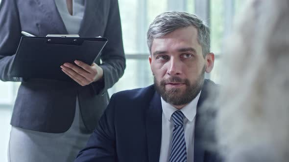 Thumbnail for Businessman Talking to Unrecognizable People