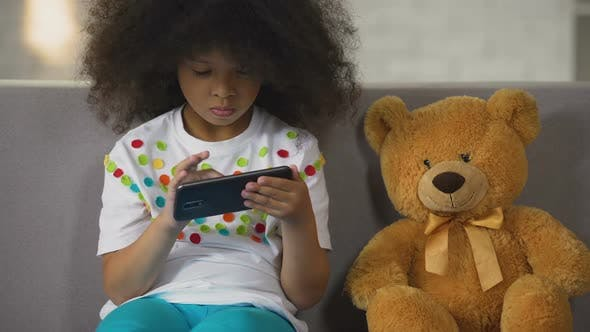 Thumbnail for African American Female Kid Practicing Math on Smartphone, Educational Apps
