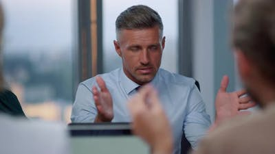 Businessman Having Meeting with Client