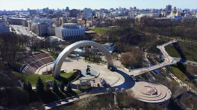 People Friendship Arch and Pedestrian Bridge of Klitschko. Reunion Arch in Kyiv, Ukraine. Aerial