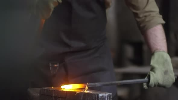 Thumbnail for Blacksmith Forging Metal on Anvil