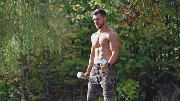 Thumbnail for Bearded shirtless man doing workout in nature